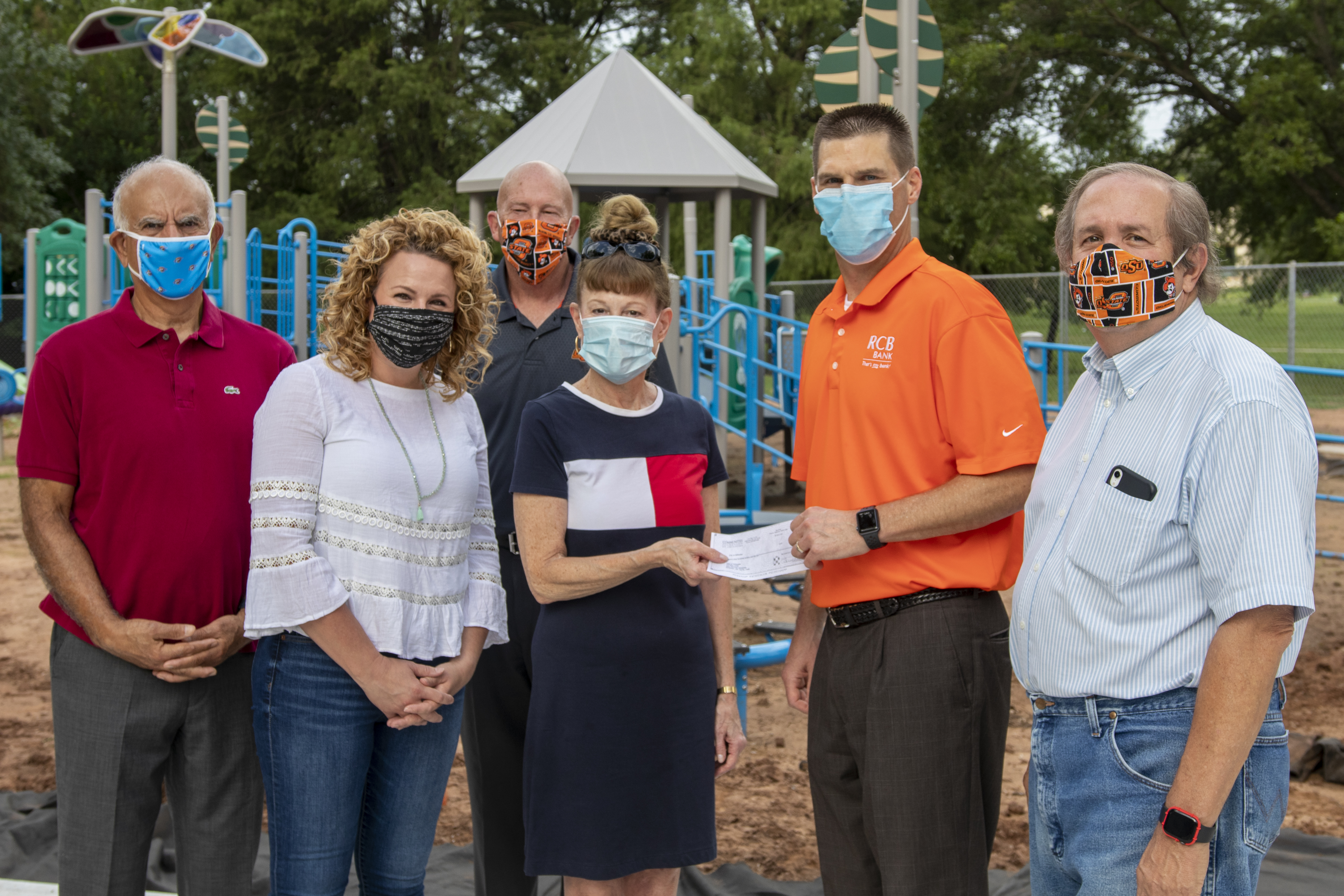 Donors from the Stillwater Community Foundation stand with City Manager Norman McNickle at Strickland Park.