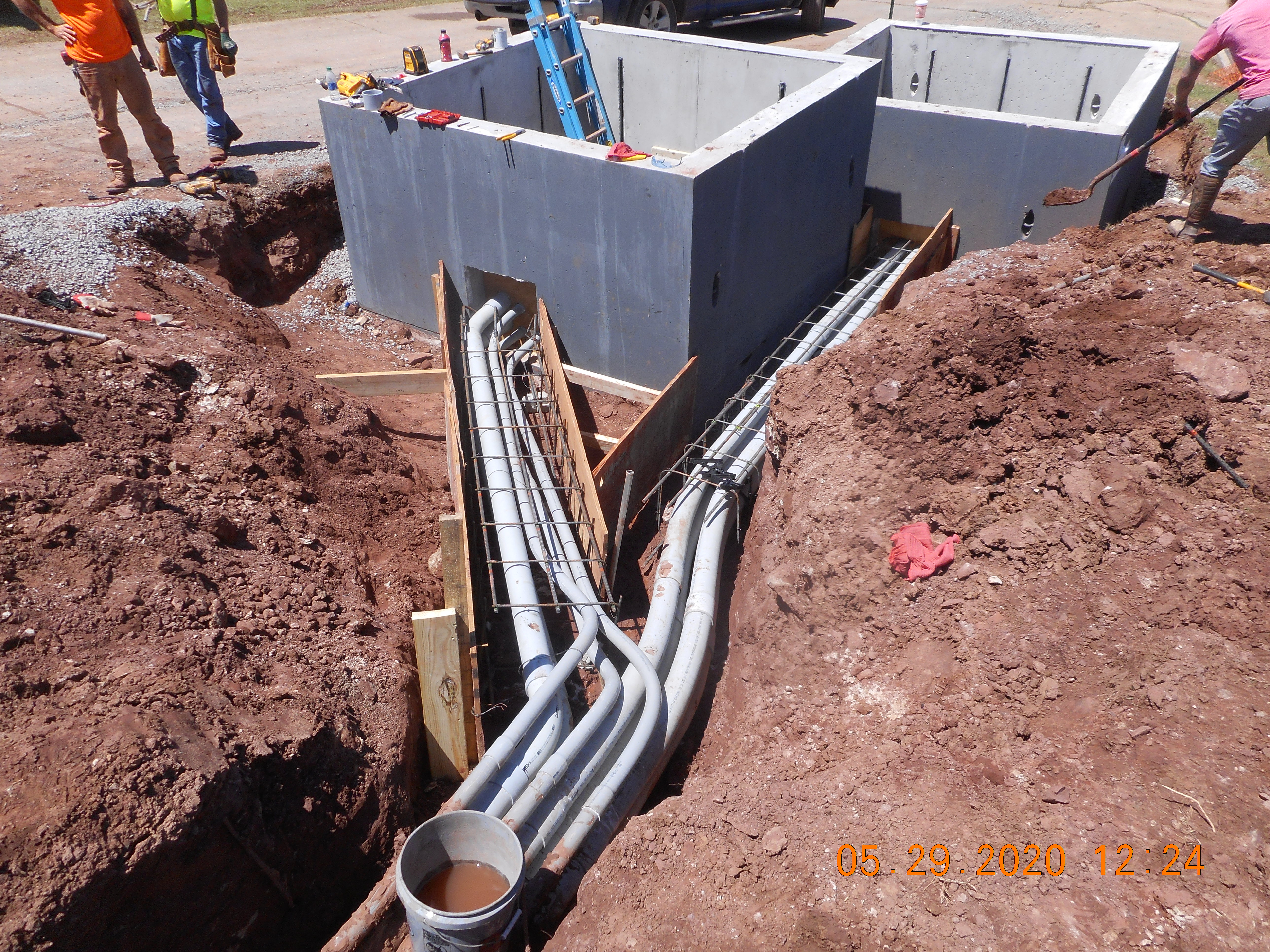 Electrical conduit installed through the vaults