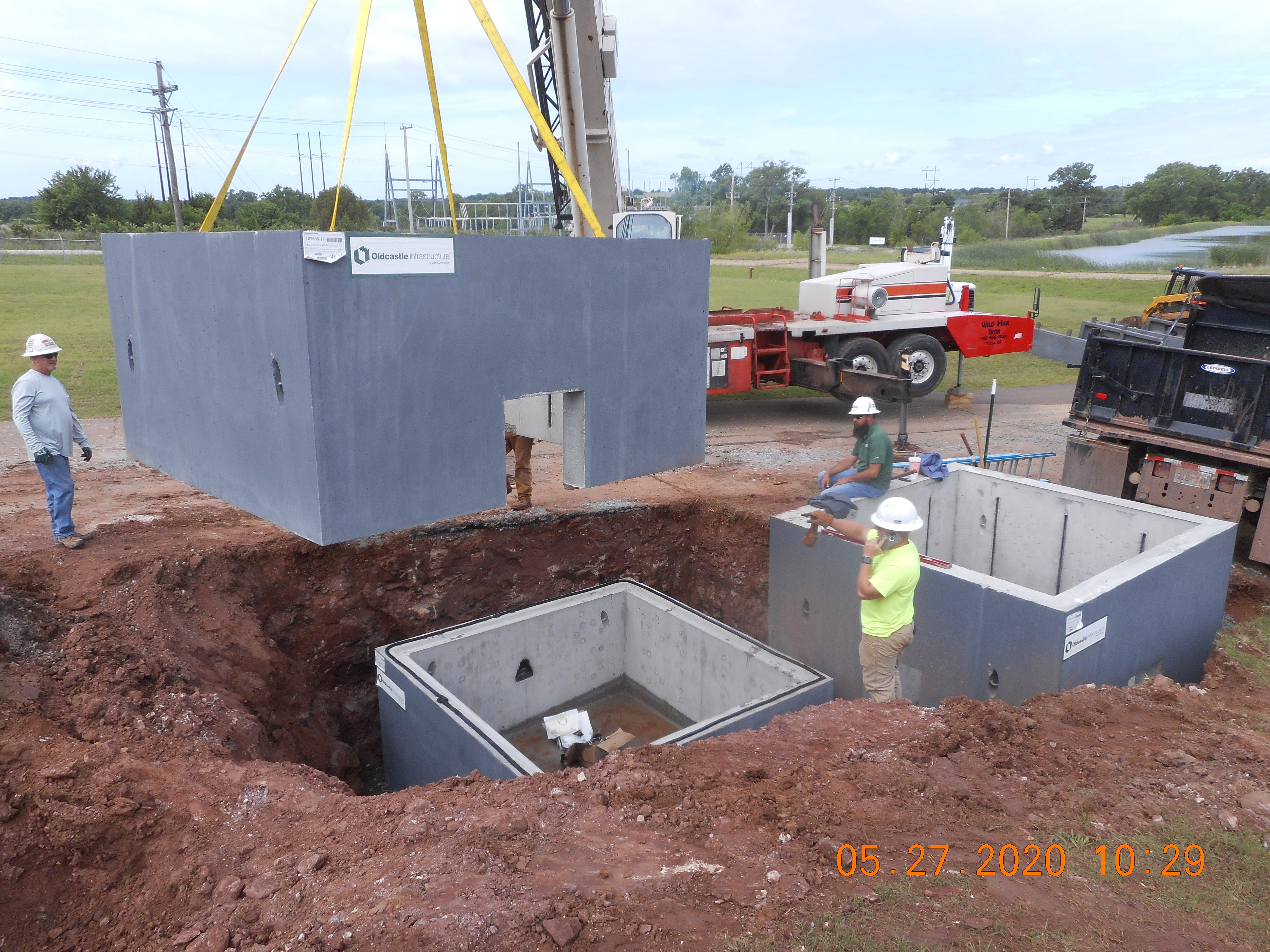 Concrete vaults being lowered into the ground