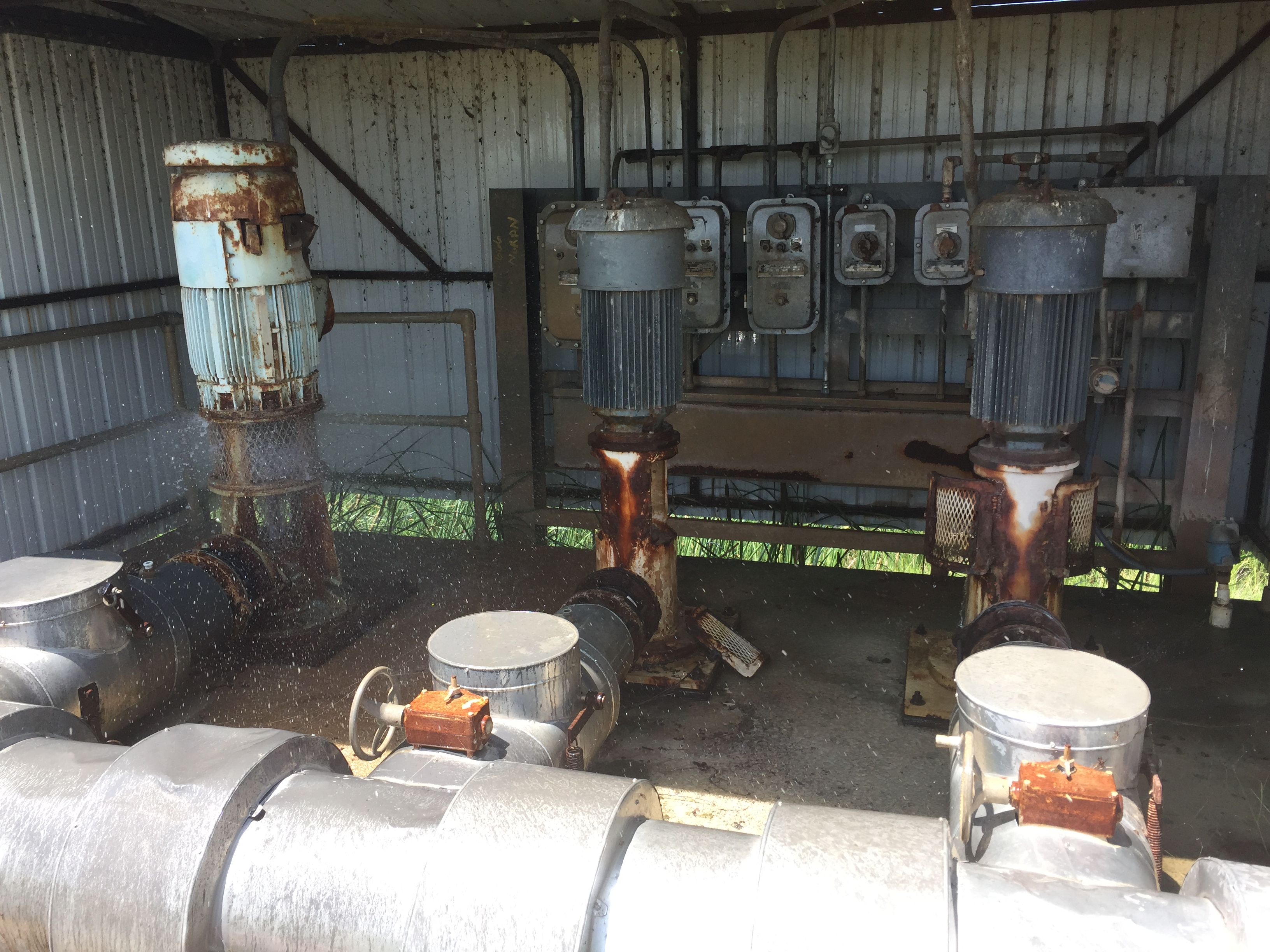 recycle pump station showing rusted and old pumps